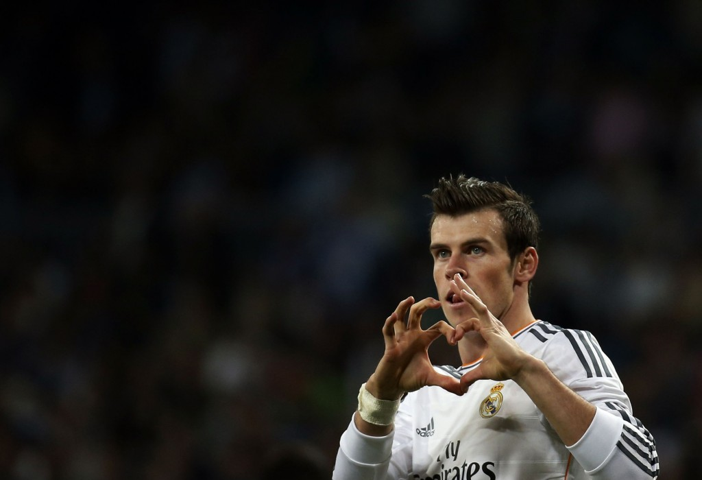 Real Madrid's Bale celebrates his goal against Almeria during their Spanish first division soccer match at Santiago Bernabeu stadium in Madrid